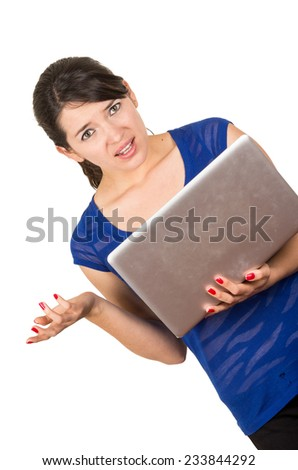 beautiful latin young woman using laptop looking confused isolated on white - stock photo