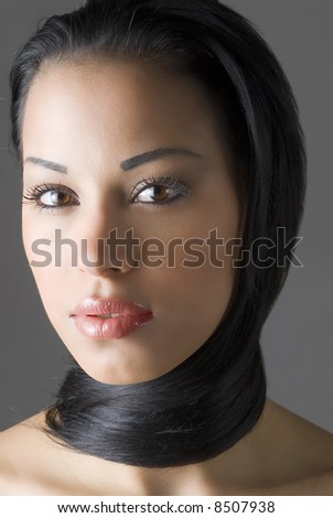 beautiful latina girl in a close up with hair around her neck