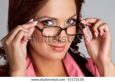 Beautiful latino woman wearing glasses - stock photo