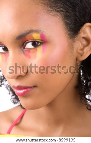 Beautiful latino woman with colorful makeup - stock photo