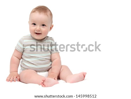 beautiful laughing baby boy sitting on white background - stock photo