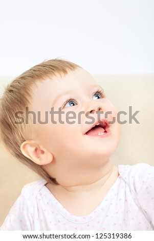 beautiful laughing baby with blue eyes portrait - stock photo
