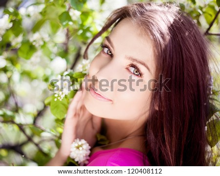 beautiful laughing brunette woman in the park on a warm summer day - stock photo