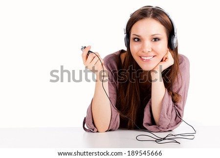 Beautiful laughing cheerful woman with headphones, white background