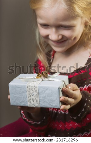 beautiful laughing girl holding presents in hands  - stock photo