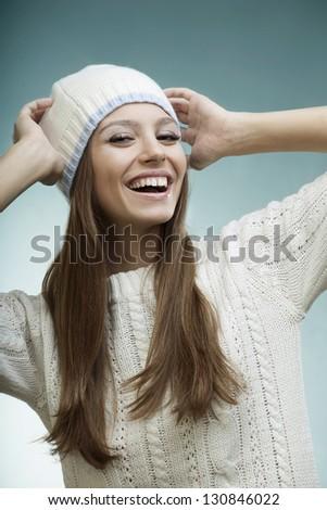 beautiful laughing girl in a warm sweater - stock photo