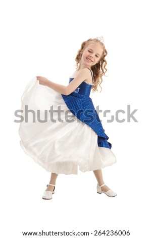 Beautiful laughing little girl with long blonde hair in the princess costume dancing in nice blue and white Empire Dress - stock photo