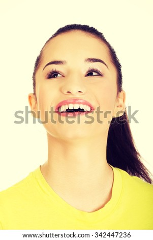 Beautiful laughing young student woman. - stock photo