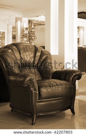 Beautiful leather armchair in a modern apartment - stock photo