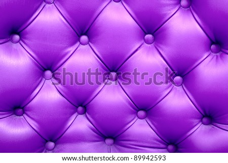beautiful leather upholstery sofa with buttons - stock photo