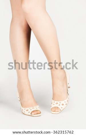 beautiful legs in elegant summer sandals on a white background - stock photo