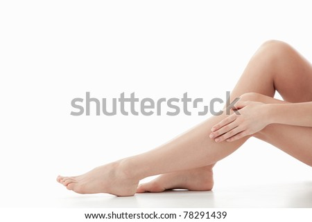 Beautiful legs on a white background - stock photo