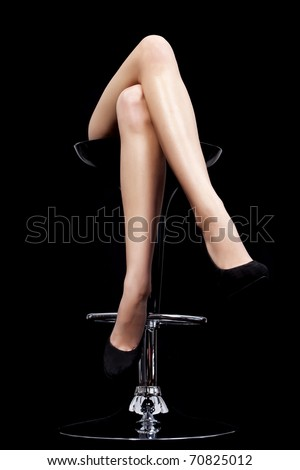 beautiful legs on black back ground - stock photo