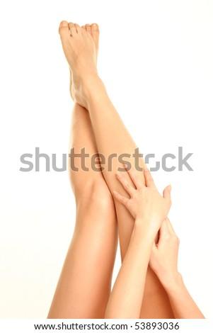 Beautiful legs on white background - stock photo