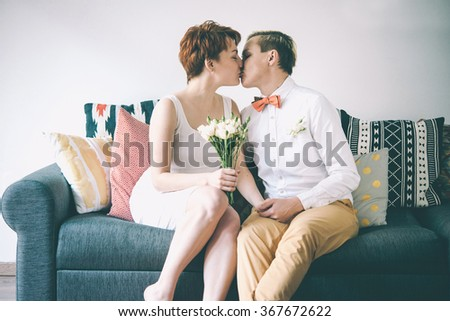 Beautiful lesbian couple celebrate their wedding. Gay marriage concept. Toned picture. Selective focus - stock photo
