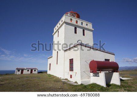 Beautiful lighthouse at Dyrholaey in Iceland - stock photo
