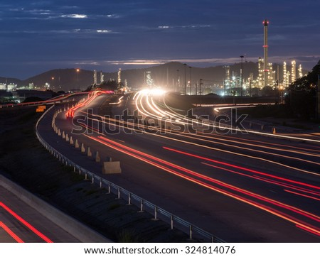 Beautiful lighting of oil refinery plant petrochemical industry with transport - stock photo
