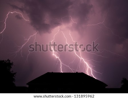 Beautiful lightning disturb the quiet country life broke the night silence. - stock photo