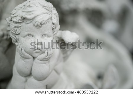 Beautiful little angel statue. Detail and portrait