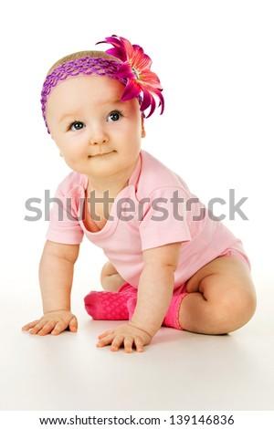 beautiful little baby sitting isolated - stock photo