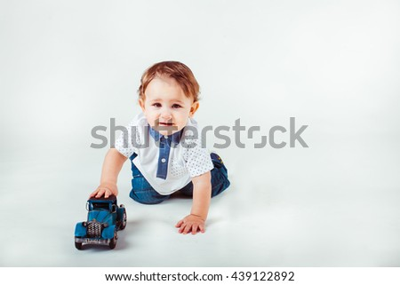beautiful little boy playing with car - stock photo