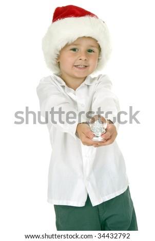 beautiful Little boy wearing santa hat holds Christmas small snowflake globe. very angelic - stock photo
