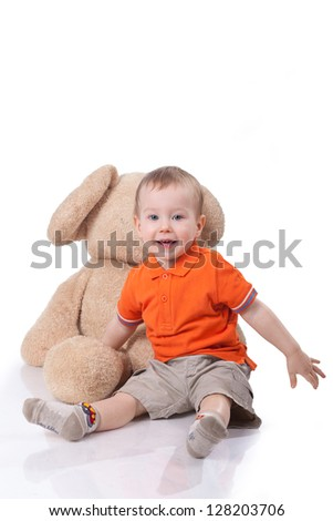 beautiful little boy with toy isolated on white - stock photo