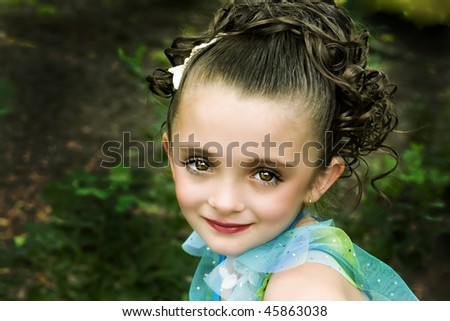 beautiful little brown-eyed, brunette girl with  make-up - stock photo