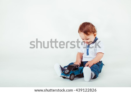 beautiful little child playing with toys in the studio