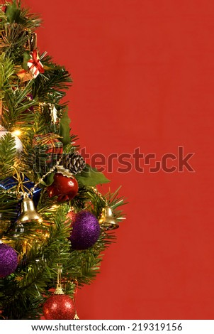 Beautiful Little Christmas Tree On Red Background With Copy Space/ Vertical Shot