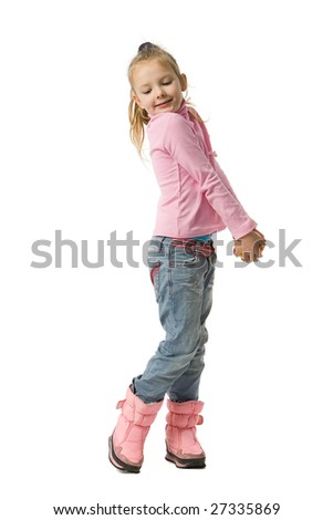 Beautiful little coquettish girl in pink clothes and in jeans, isolated on white