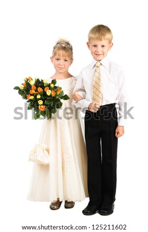 beautiful little couple of kids wearing fancy attire isolated over white background - stock photo
