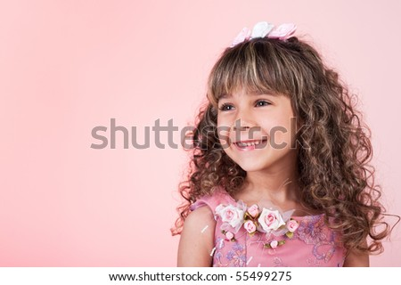 Beautiful little curly girl smiling - stock photo