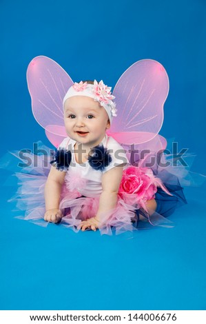 beautiful little fairy on a blue background