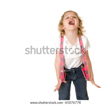 beautiful little fashion model on white background screaming and stretching her red suspenders out to the sides