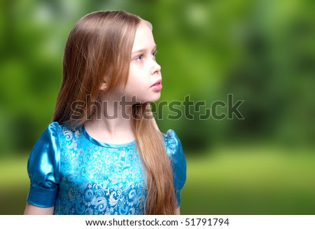 Beautiful little girl / child blonde, profile portrait, looking, isolated against white background, studio