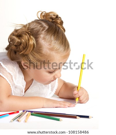 beautiful  little girl  drawing with multicolored pencils isolated on white - stock photo