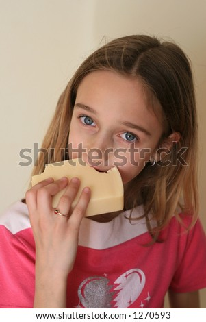 Beautiful Little Girl Eating Cheese