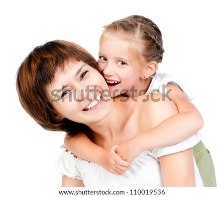 beautiful little girl embraces mother for shoulders - stock photo