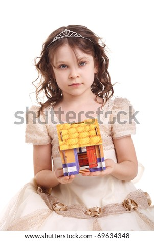 beautiful little girl holding a toy house in her hands - stock photo