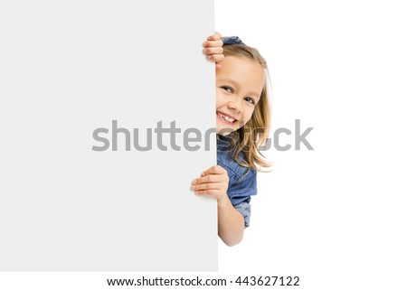 Beautiful little girl holding and showing something on a whiteboard