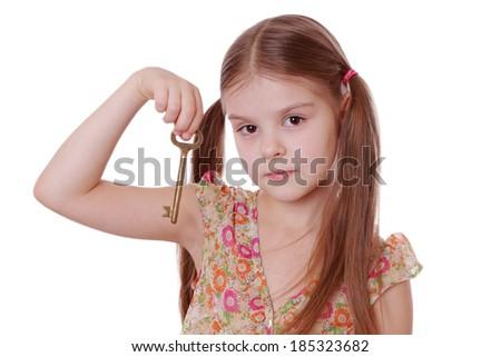 beautiful little girl holding golden vintage old key - stock photo