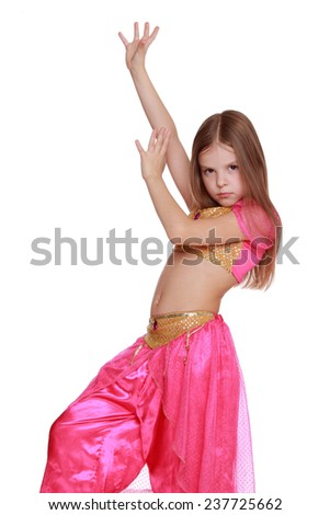 Beautiful little girl in a pink dancing suit isolated on a white background/Little arabic belly-dancer