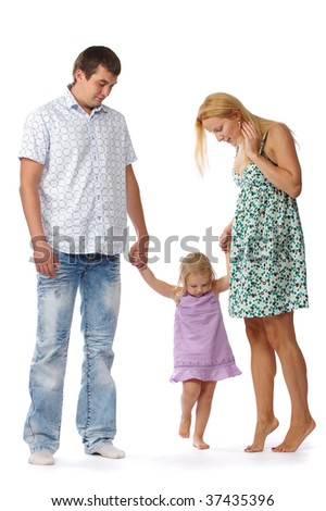 beautiful little girl in a purple dress holding the hand of their parents