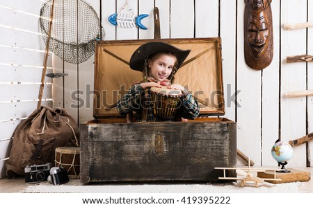 beautiful little girl in cowboy hat with drum