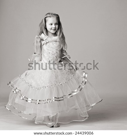 beautiful little girl in dress of princess with diadem on long hair barefoot stand isolated on white - stock photo