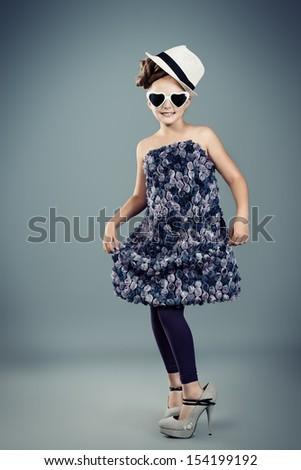 Beautiful little girl in fashionable dress.  - stock photo