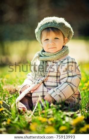 beautiful little girl in flowers field - stock photo