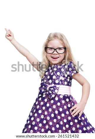 Beautiful little girl in glasses showing on something by finger isolated over white background - stock photo