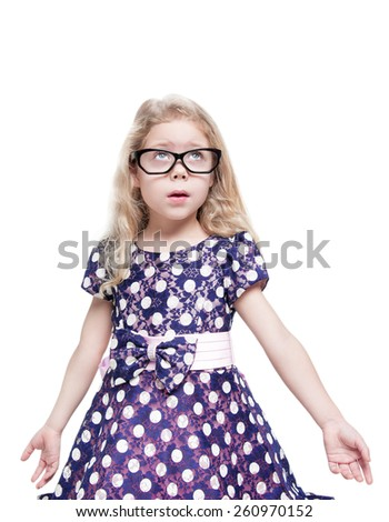 Beautiful little girl in glasses surprised looking up on something isolated  - stock photo